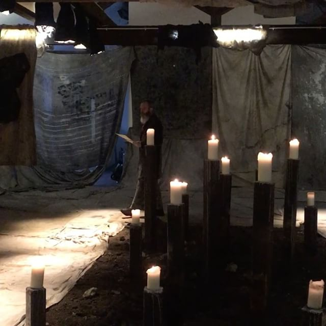 draped rags and pillar candles